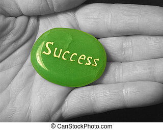 Success stone in a black and white hand