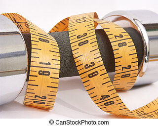 Weight & Measure - Close-up photo of a hand weight and...