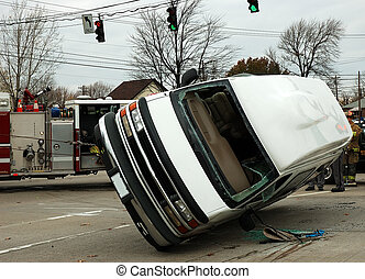 Traffic Accident Series - Tow truck cables are lifting a van...