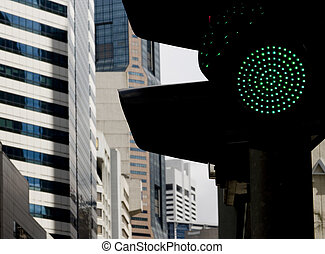 Green Light for Business - A traffic lights shows green in...