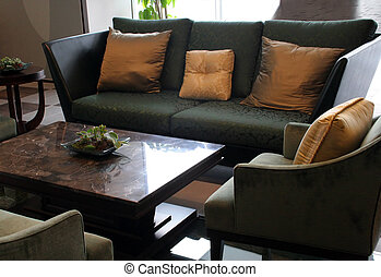 Living room - Sofas, chairs and a table in a living room