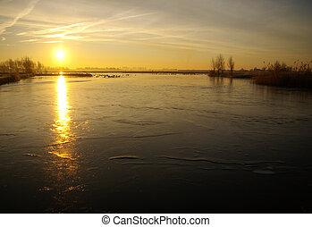 Dutch frozen lake - Frozen lake at sunrise in Holland