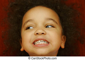 These Are My Teeth - A young mixed race girl smiling broadly...