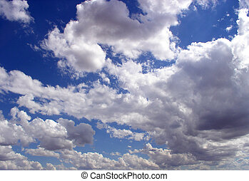 puffy clouds on a deep blue sky