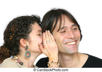 Whispering secrets - Woman whispering something in her...