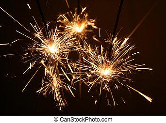 Sparklers - Three litten sparkles.