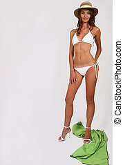 Woman standing in bikini and posing