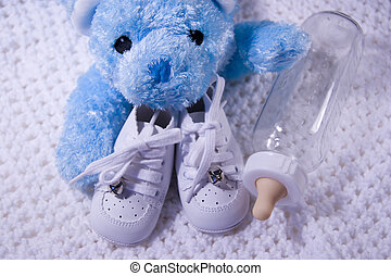 Baby Items - Pair of Babies shoes with Teddy Bear and Bottle