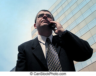 Business communication - Businessman speaking to the mobile...