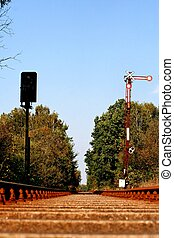 view rail bed signal - flat view from railroad track bed of...