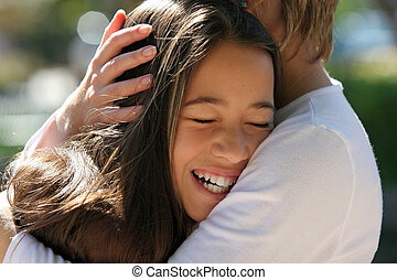 Mothers hands - Mother hugging her happy daughter