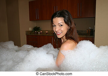 Bubble Bath Girl - Smiling girl in bubble bath with candles...