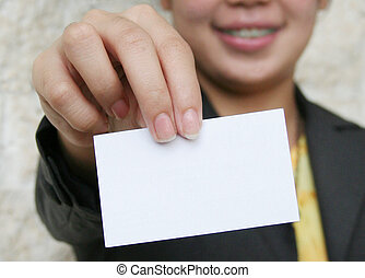 Business Card - Woman holding out blank business card; focus...