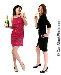 Girls Drinking Champagne - Two girls drinking champagne at a...