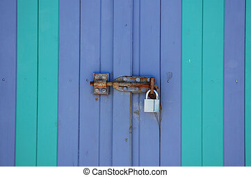 Boat shed locked - The door lock on a colorful beach boat...