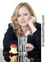 Dieters lunch - woman staring at a half eaten apple and...