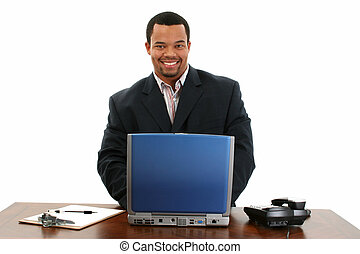 Man Computer Desk - Handsome African American male standing...