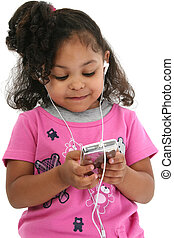 Girl Child Music - Three-year-old girl in pink listening to...