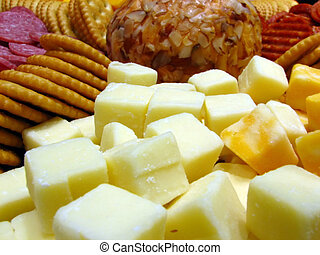 Cheese Tray - Closeup of a cheese tray with saltine crackers...