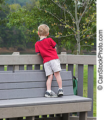 Child alone - Lone child in park wishing he had a playmate