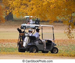 Golfing in fall - Playing golf on a beauttiful sunny day on...