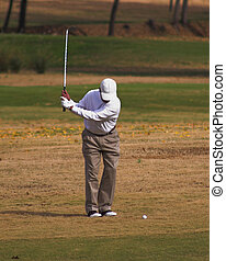 Golfer 3 - Playing golf on a beauttiful sunny day on the...