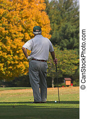 Golfer waiting - Playing golf on a beautiful sunny day