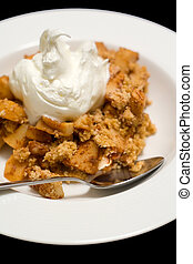 Apple Crumble - Dessert, isolated against black background