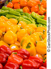 Peppers at the Grocers - Piles of red, yellow, and orange...