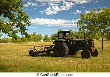 Mowing tractor - Farmland. Uruguay.