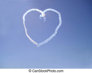 skywriting - Stunt airplane making heart figure in the sky