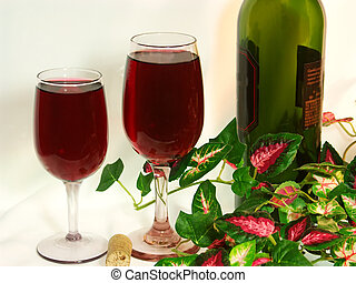 Pair of wine glasses filled with delicous red wine, grouped...