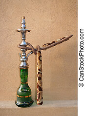 Shisha Single - An Arabic Shisha pipe sitting on a sandstone...