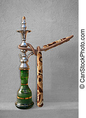 Shisha Single - Desaturated - An Arabic Shisha pipe sitting...