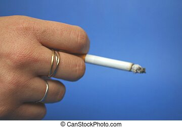 cigarette - Cigarette voluntarily vague between fingers