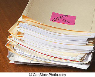 Urgent files - PIle of urgent files on desk