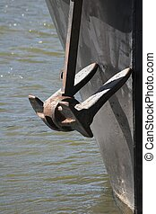 anchor - Closeup of ships anchor on river at dockside well...