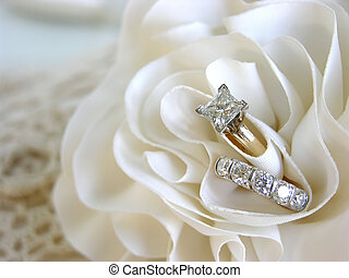 Wedding Ring Background - Diamond wedding rings in the folds...