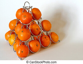 pyramid of fruit - oranges stacked onto a fruit stand