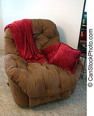 Recliner Chair - Shot of a brown recliner chair with a deep...