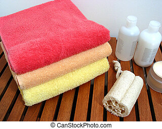 Spa or bathroom accessories: stack of colorful towels,...