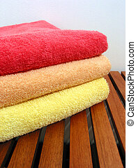 Towel stack 2 - Stack of bright colorful clean towels on a...