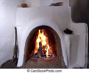 White Adobe Fire - Adobe wood burning fireplace in Taos, New...