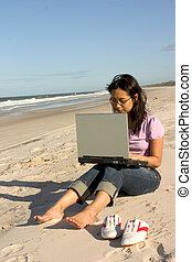 Working Outdoor - Asian girl working with laptop at Bribie...