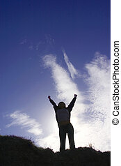 Woohoo! - Silhouette of man celebrating his success