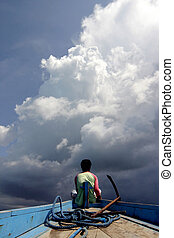 Fisherman - Indonesian fisherman watching big clouds coming...