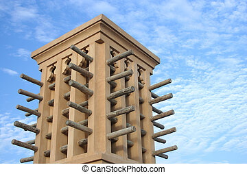 Wind Tower - an arabic wind tower against a cloudy sky