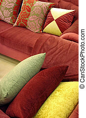 Sofa and chair with luxurious pillows