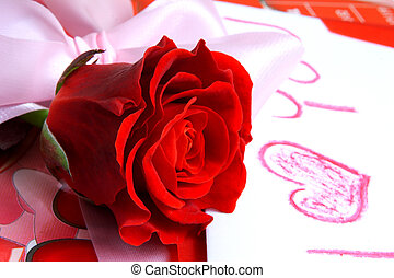 Love - Red rose and valentine gift.