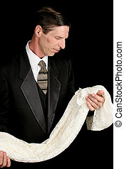 Grieving Widower - A widower holding a dress and grieving...